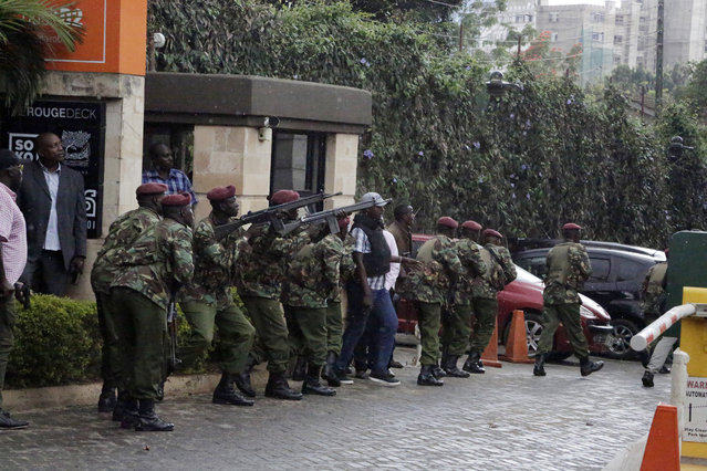 Security forces are seen at the scene of a blast in Nairobi, Tuesday, January 15, 2019.Terrorists attacked an upscale hotel complex in Kenya's capital Tuesday, sending people fleeing in panic as explosions and heavy gunfire reverberated through the neighborhood. (Photo by Khalil Senosi/AP Photo)