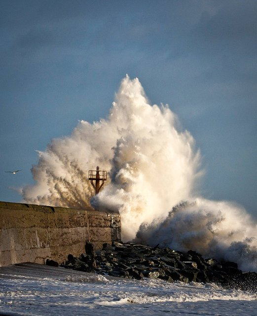 Giant waves break over the pier on the South beach, Arklow, Co Wicklow as high winds continue to lash the country, on December 27, 2013. (Photo by Garry O'Neill/PA Wire)