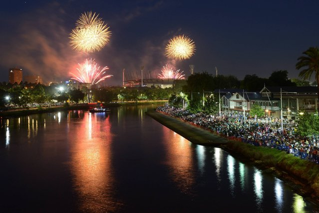 9.30PM fireworks over The Melbourne Cricket Ground and Yarra River during New Years Eve fireworks on December 31, 2013 in Melbourne, Australia. (Photo by Vince Caligiuri/Getty Images)