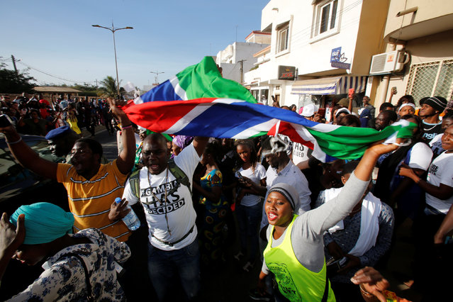Supporters of president-elect Adama Barrow celebrate his inauguration at Gambia's embassy in Dakar, Senegal January 19, 2017. (Photo by Thierry Gouegnon/Reuters)