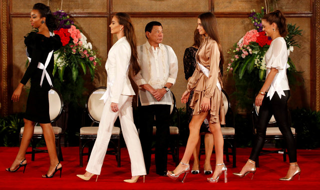 Philippine President Rodrigo Duterte looks at Miss Universe candidates at the presidential palace in Manila, Philippines January 23, 2017. (Photo by Erik De Castro/Reuters)