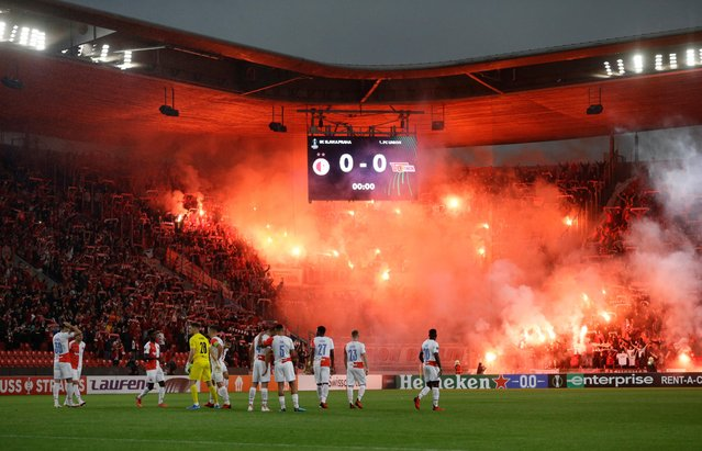 Fans with flares in the stands before the Europa Conference League match between Slavia Prague and Union Berlin in Prague, Czech Republic on September 16, 2021. (Photo by David W. Cerny/Reuters)