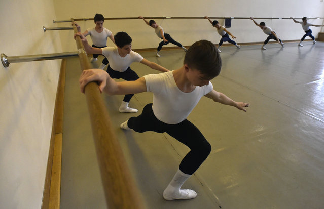 Students attend a class in the Moscow State Academy of Choreography, better known as the Bolshoi Ballet Academy, in Moscow, on March 3, 2016. The academy, which was founded in 1773 by Empress Catherine the Great, produced famous Soviet ballet-dancers Olga Lepeshinskaya, Maya Plisetskaya, Maris Liepa, among many others. (Photo by Yuri Kadobnov/AFP Photo)