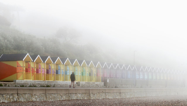 A lady walks along the promenade during a foggy morning in Folkestone, Kent, United Kingdom on Monday, June 7, 2021. (Photo by Gareth Fuller/PA Images via Getty Images)