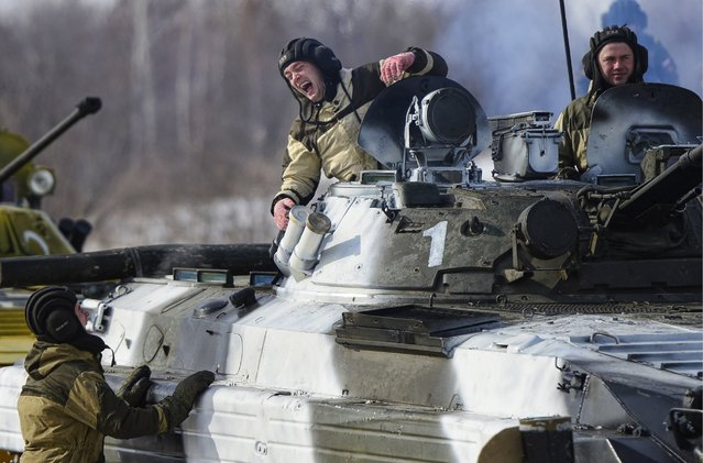 A member of a tank crew laughs at the regional stage of the 2016 Tank Biathlon Competition at the Anastasyevsky training ground, March 1, 2016, Khabarovsk Territory, Russia. (Photo by Yuri Smityuk/TASS/Newscom)