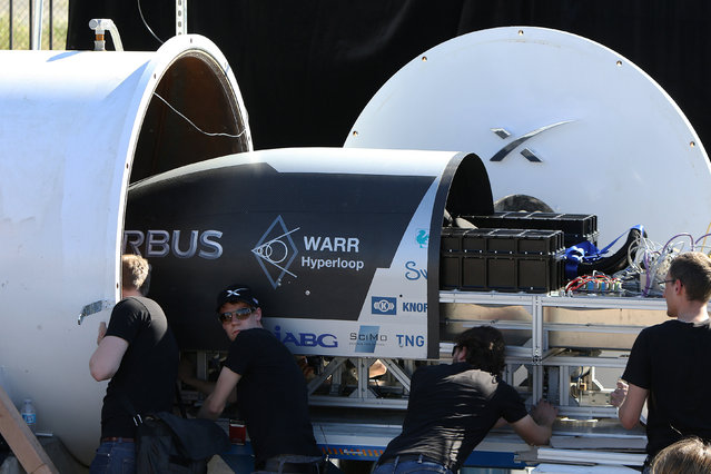 Team members from WARR Hyderloop, Technical University of Munich place their pod on the track during the SpaceX Hyperloop Pod Competition in Hawthorne, Los Angeles, California, U.S., January 29, 2017. (Photo by Monica Almeida/Reuters)
