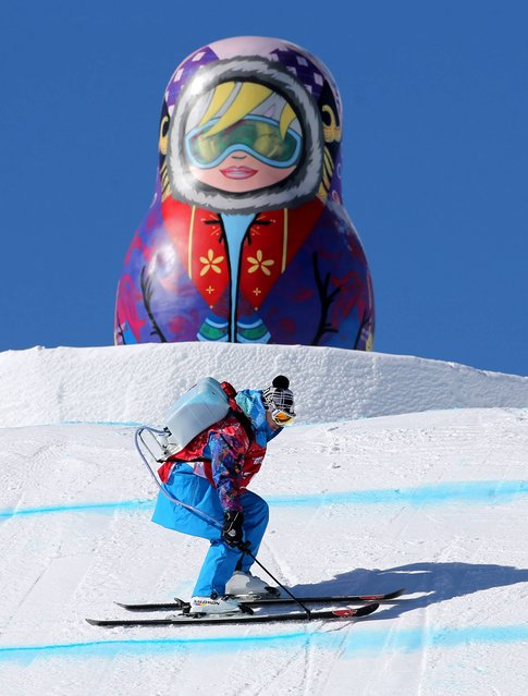 Paint is sprayed on the slopestyle course at the Rosa Khutor Extreme Park,  Rosa Khutor Extreme Park, Sochi, Russia, on ebruary 3, 2014. (Photo by Andrew Milligan/PA Wire)