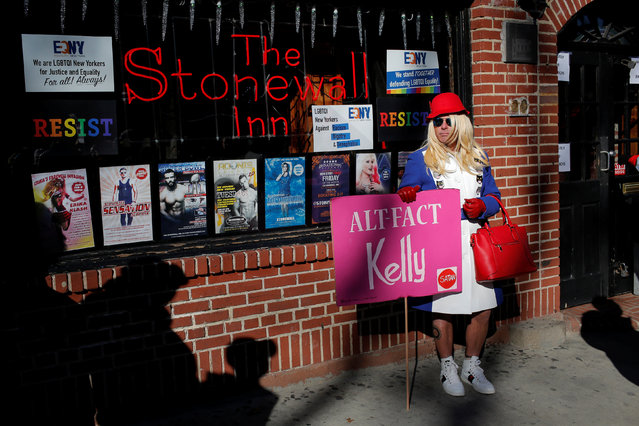 A person dressed as Kellyanne Conway, counselor to U.S. President Donald Trump, stands outside The Stonewall Inn during a gathering of the LGBTQ community and supporters protesting Trump's agenda in Manhattan, New York, U.S., February 4, 2017. (Photo by Andrew Kelly/Reuters)