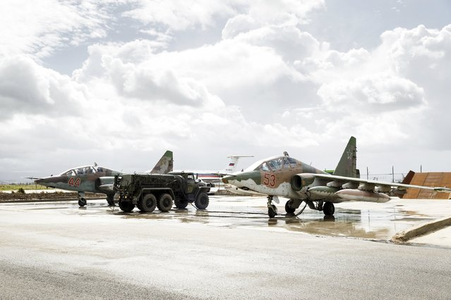 Russian Sukhoi Su-25 fighter jets are seen shortly before the take-off, part of the withdrawal of Russian troops from Syria, at Hmeymim airbase, Syria, March 15, 2016. (Photo by Vadim Grishankin/Reuters/Russian Ministry of Defence)