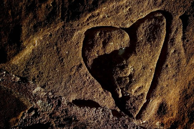 A hand-carved heart marks the wall inside the castle at Coronado Heights in Salina County, Kansas. (Photo by Rodrick Reidsma/Salina Journal)