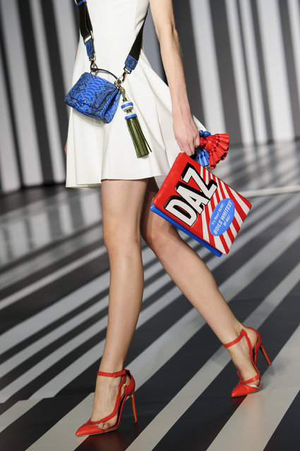 A model wears an accessory created by Anya Hindmarch during London Fashion Week Autumn/Winter 2014, in central London in central London, Tuesday, February 18, 2014. (Photo by Jonathan Short/Invision/AP Photo)