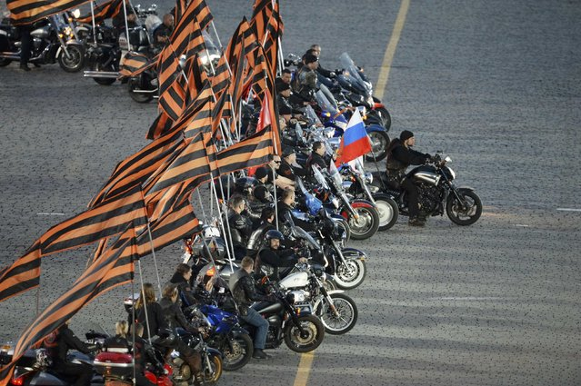 "Leader of the motorcycling club Night Wolves Alexander Zaldostanov (R), nicknamed ""Khirurg"" (Surgeon), performs during a festive concert marking the 70th anniversary of the end of World War Two in Europe, at Red Square in Moscow, Russia, May 9, 2015. (Photo by Reuters/Host Photo Agency/RIA Novosti)"