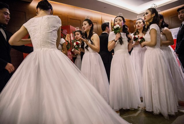 Debutantes from a local academy gather before taking part in the Vienna Ball at the Kempinski Hotel, March 19, 2016, in Beijing. (Photo by Kevin Frayer/Getty Images)