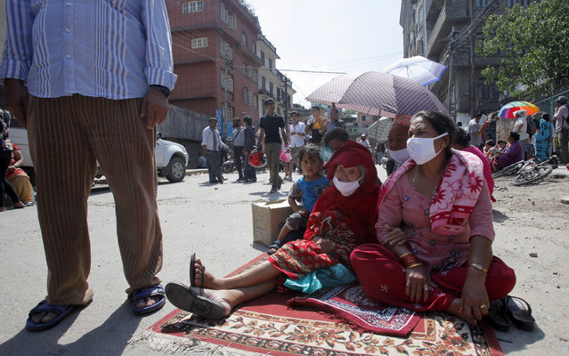 Nepalese people take refuge on a street after an earthquake hit Kathmandu, Nepal, Tuesday, May 12, 2015. (Photo by Bikram Rai/AP Photo)