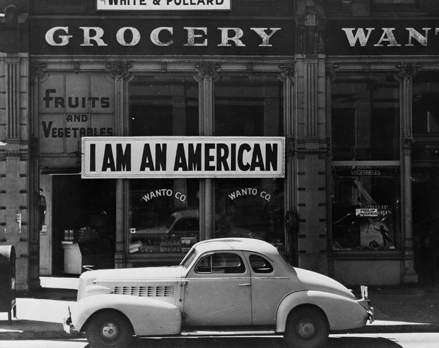 """A large sign reading """"I am an American"""" placed in the window of a store, at 13th and Franklin streets, on December 8, the day after Pearl Harbor, is pictured in Oakland, California in this March 1942 handout photo. (Photo by Courtesy Dorothea Lange/Farm Security Administration and Office of War Information Collection/Library of Congress/Reuters)"""