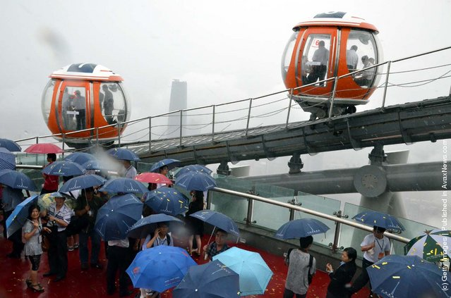A general view of the ferris wheel on the roof of 450-metre-high Canton Tower during test run