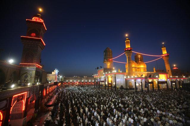 Shiite pilgrims pray at the Imam Mousa al-Kazim shrine to commemorate his death, in the Shiite district of Kazimiyah, Baghdad, Iraq, Wednesday, May 13, 2015. (Photo by Karim Kadim/AP Photo)