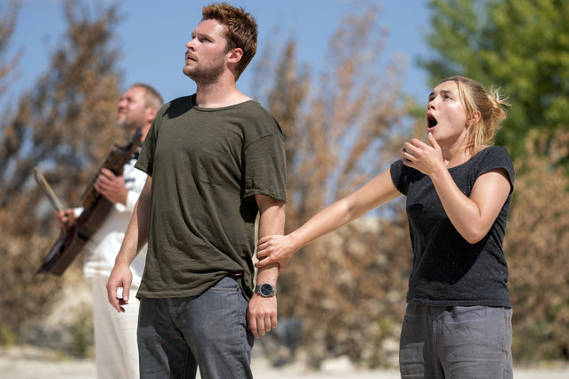 "This image released by A24 shows Jack Reynor and Florence Pugh, right, in a scene from the horror film ""Midsommar"". (Photo by Gabor Kotschy/A24 via AP Photo)"