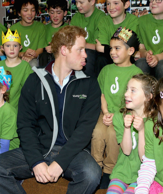 Prince Harry sits with pupils at Halfmoon Bay School in Oban as he leaves on May 11, 2015 in Stewart Island, New Zealand. Prince Harry is in New Zealand from May 9 through to May 16 attending events in Wellington, Invercargill, Stewart Island, Christchurch, Linton, Whanganui and Auckland. (Photo by Chris Jackson/Getty Images)