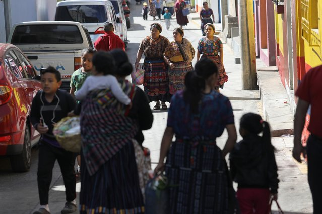 Women in traditional Mayan dress walk to a market on February 11, 2017 in Almolonga, Guatemala. (Photo by John Moore/Getty Images)
