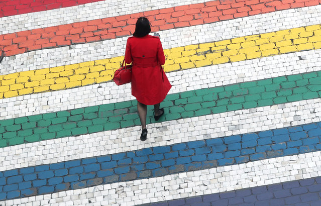 A woman crosses a road outside the EU Parliament ahead of the EU elections in Brussels, Belgium, May 22, 2019. (Photo by Yves Herman/Reuters)