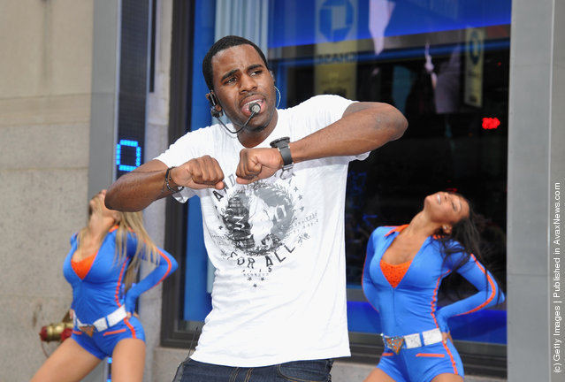 Singer Jason Derulo performs during his Flash Mob with Knicks City Dancers outside of Madison Square Garden