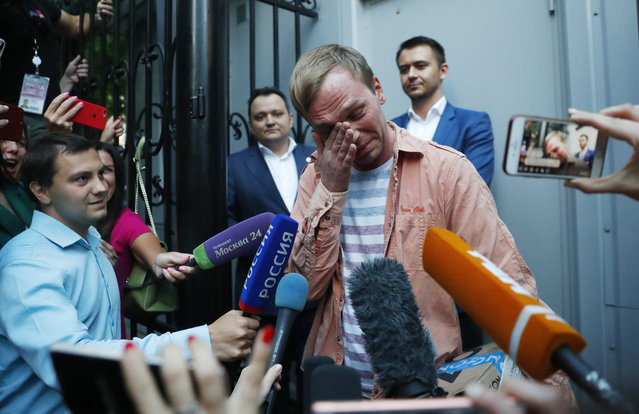 Prominent Russian investigative journalist Ivan Golunov, cries as he leaves a Investigative Committee building in Moscow, Russia, Tuesday, June 11, 2019. In a surprising turnaround, Russia's police chief on Tuesday dropped all charges against a prominent investigative reporter whose detention sparked public outrage and promised to go after the police officers who tried to frame the journalist as a drug-dealer. (Photo by Pavel Golovkin/AP Photo)