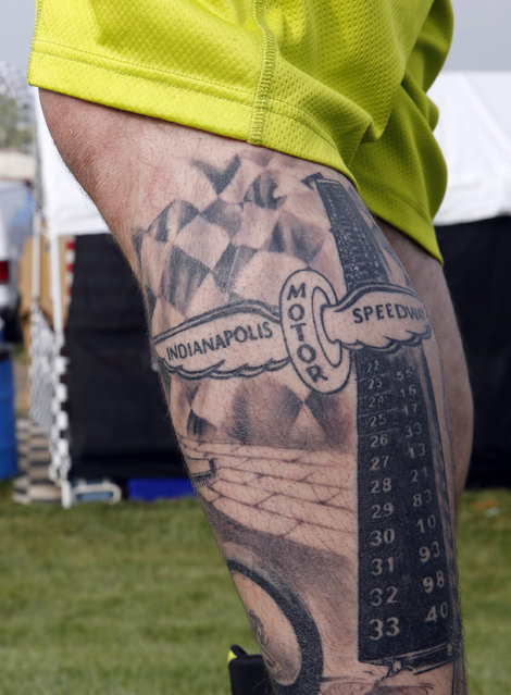 Jesse Kindred, of Indianapolis, shows the race-themed tattoo on his leg before the 99th running of the Indianapolis 500 auto race at Indianapolis Motor Speedway in Indianapolis, Sunday, May 24, 2015. (Photo by A. J. Mast/AP Photo)