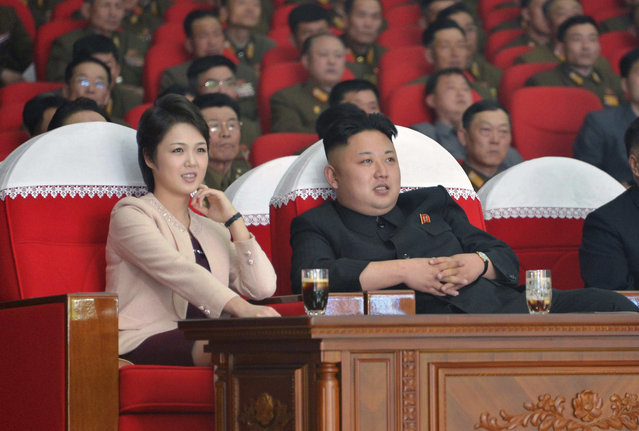 North Korean leader Kim Jong Un and his wife Ri Sol Ju watch a performance by the Moranbong Band at the April 25 House of Culture in this undated photo released by North Korea's Korean Central News Agency (KCNA) in Pyongyang on March 24, 2014. (Photo by Reuters/KCNA)
