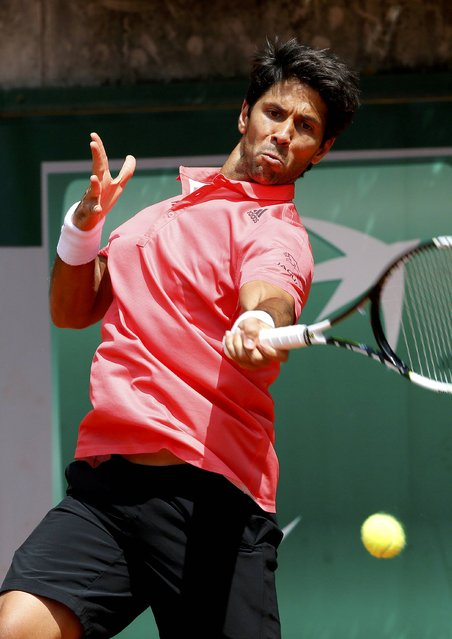 Fernando Verdasco of Spain plays a shot to Japan's Taro Daniel during their men's singles match at the French Open tennis tournament at the Roland Garros stadium in Paris, France, May 25, 2015. (Photo by Gonzalo Fuentes/Reuters)