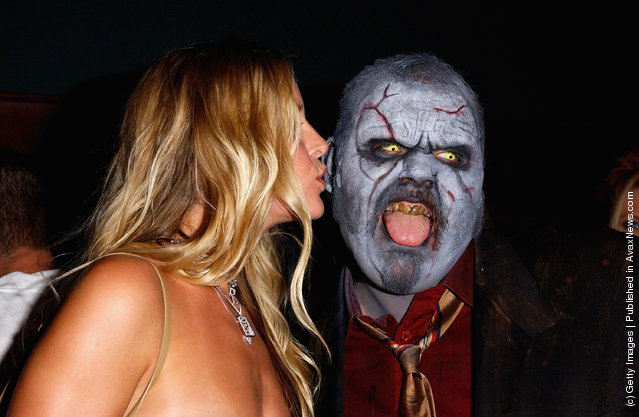Actress Sheri Moon kisses a zombie
