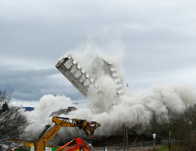 The Bonn Center topples during a controlled demolition in Bonn, Germany, March 19, 2017. (Photo by Thilo Schmuelgen/Reuters)