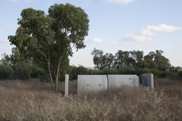 In this Tuesday, June 23, 2015, photo, a bomb shelter placed in an open field that used as army tanks staging area during the 2014 Israeli Gaza war, near the southern Israeli town of Sderot, next to Israeli Gaza border. (Photo by Oded Balilty/AP Photo)