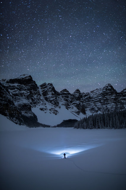 One of Pauls amazing self portraits. at Moraine Lake, Canada. (Photo by Paul Zizka/Caters News Agency)
