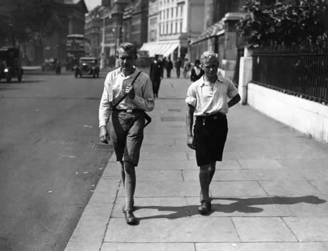Two young men out for a walk wearing shorts because of a heatwave in London, 1932. (Photo by Getty Images)