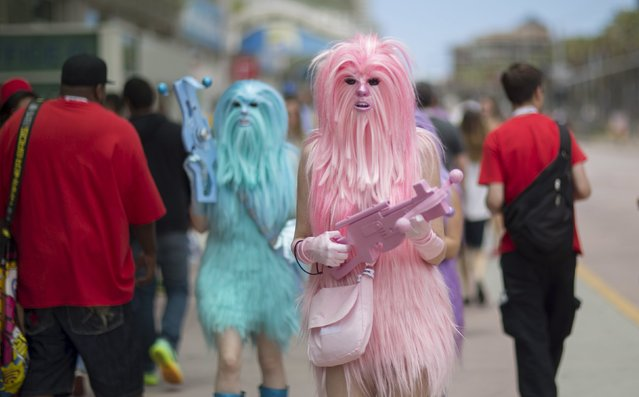 """Star Wars enthusiasts wear costumes resembling what they say are """"Chew's Angels"""" during the 2015 Comic-Con International Convention in San Diego, California July 10, 2015. (Photo by Mario Anzuoni/Reuters)"""