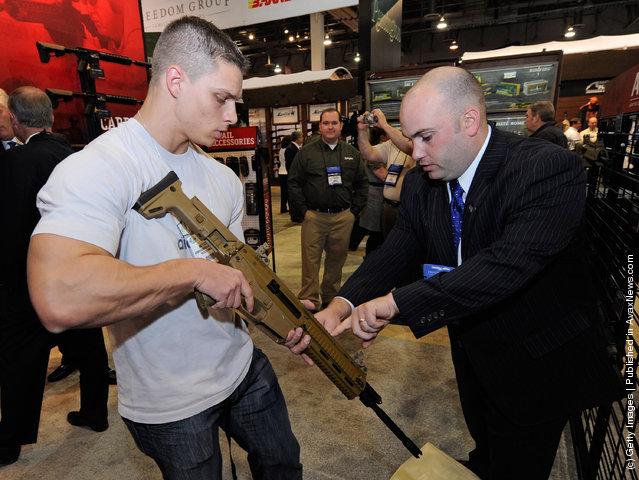 Ed Mazzeo (R) with Bushmaster Firearms shows Matteo Martini a semi-auotmatic Bushmaster Enhanced Adaptive Combat Rifle (ACR)