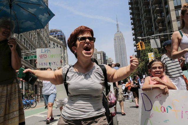 Michelle Kraus (C), 45, suffering from dwarfism, shouts slogans to support disabled people while she takes part in the disability pride parade in New York, July 12, 2015. (Photo by Eduardo Munoz/Reuters)