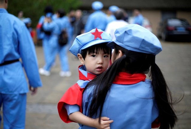 Children dressed in replica uniforms of Red Army are seen at a revolutionary site in Yanan, Shaanxi province, China, June 27, 2019. (Photo by Jason Lee/Reuters)