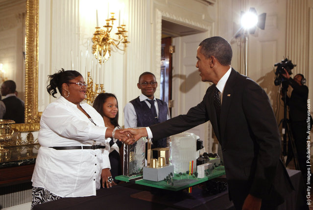 U.S. President Barack Obama (R) greets Jayla Mae Dogan, Ashley Cassie Thomas, and Lucas Cain Beal, all 13, of Detroit, Michigan, who are part of a team who focused on designing a city around the theme of 'Fuel Your Future: Imagine New Ways to Meet Our Energy Needs and Maintain a Healthy Planet,' while touring student science fair projects on exhibit in the State Dining Room at the White House