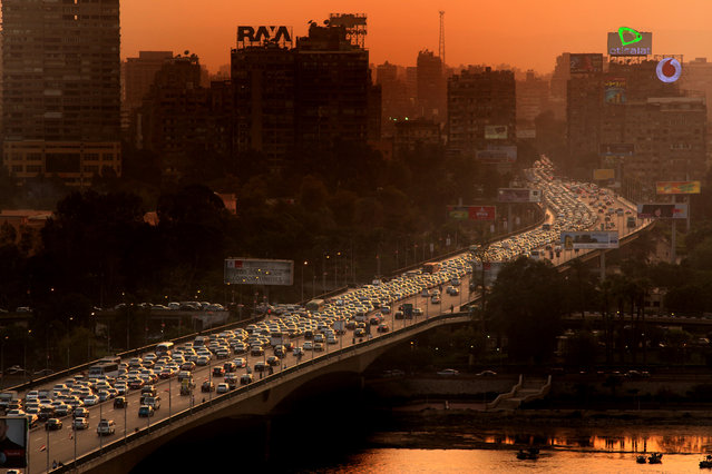 """Traffic Jam"". A bridge In Cairo, sunset time. Photo location: Cairo, Egypt. (Photo and caption by Zouheir Al-Najjar/National Geographic Photo Contest)"