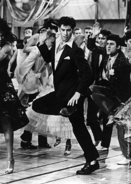 1978: Singing and dancing, actor John Travolta struts his stuff in the hit musical film 'Grease', a romantic comedy set in the 1950's rock 'n' roll era, in which Travolta stars with Olivia Newton-John