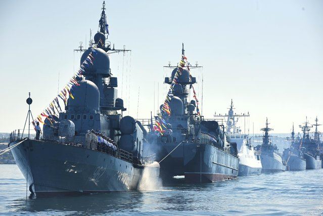 Russian navy battle ships station in the bay during a rehearsal of the Russian Navy Day parade in Sevastopol, Crimea, Friday, July 24, 2015. (Photo by Alexander Polegenko/AP Photo)