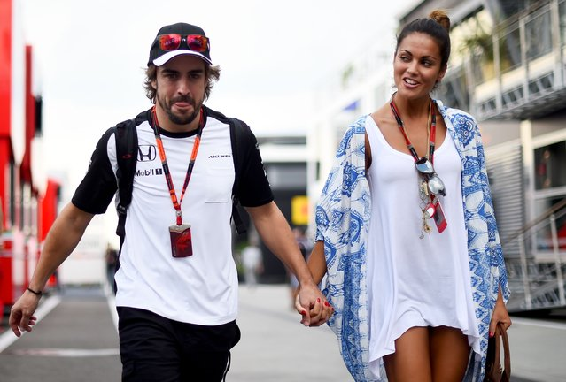 Fernando Alonso of Spain and McLaren Honda and his girlfriend Lara Alvarez walk in the paddock after qualifying for the Formula One Grand Prix of Hungary at Hungaroring on July 25, 2015 in Budapest, Hungary. (Photo by Lars Baron/Getty Images)