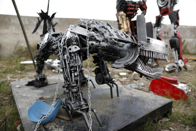 """A """"Transformers"""" replica is seen on the outskirts of Shanghai, June 18, 2014. Li Lei, owner of a small factory, uses his spare time and money to build """"Transformers"""" replicas for rent or sale. The new Transformers movie, which is premiering later this month, has brought the factory many new orders, according to Li. (Photo by Aly Song/Reuters)"""