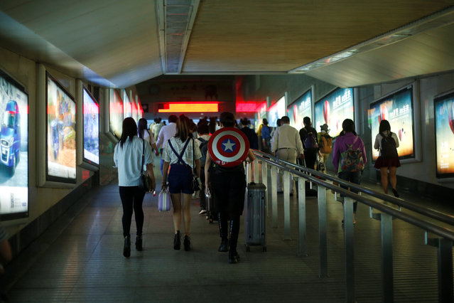 "A passenger dressed as ""Captain America"" walks at a railway station in Shanghai, China June 6, 2016. (Photo by Aly Song/Reuters)"