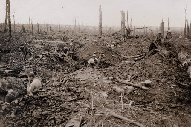 British troops are pictured in trenches on the devastated battlefield during the battle of the Somme in this 1916 handout picture. This picture is part of a previously unpublished set of World War One (WWI) images from a private collection. The pictures offer an unusual view of varied and contrasting aspects of the conflict, from high tech artillery to mobile pigeon lofts, and from officers partying in their headquarters to the grim reality of life and death in the trenches. The year 2014 marks the centenary of the start of the war. (Photo by Reuters/Archive of Modern Conflict London)