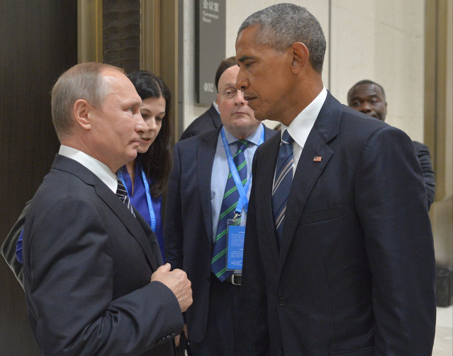 """In this Sept. 5, 2016 file photo, Russian President Vladimir Putin, left, speaks with U.S. President Barack Obama in Hangzhou in eastern China's Zhejiang province. The Russian Foreign Ministry said on Thursday, October 13, 2016, that the United States is conducting a """"scorched earth"""" policy in relation to Russia during the final months of Obama's presidency. (Photo by Alexei Druzhinin/Sputnik/Kremlin Pool Photo via AP Photo)"""