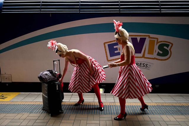 Elvis fans arrive at Central station before boarding a train to The Parkes Elvis Festival, in Sydney on January 9, 2020. The Parkes Elvis Festival is an annual event celebrating the music and life of Elvis Presley in the New South Wales town of Parkes. (Photo by Peter Parks/AFP Photo)