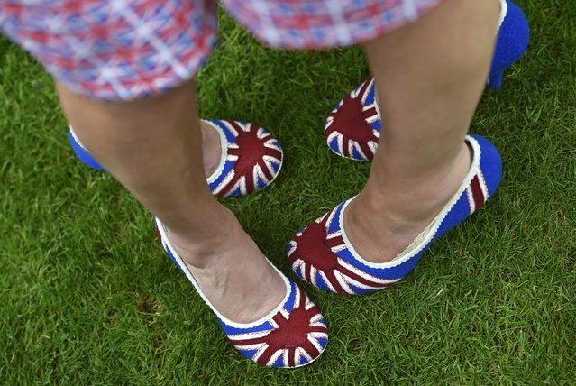 Britain Horse Racing, Royal Ascot, Ascot Racecourse on June 16, 2016. Ladies Day Racegoers wear union flag shoes. (Photo by Toby Melville/Reuters)